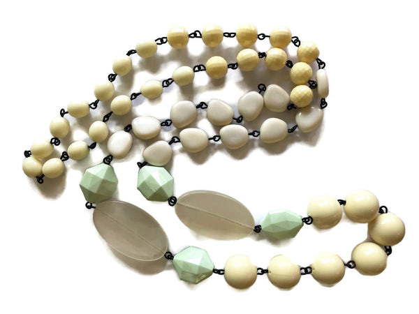 neutral long beaded necklace