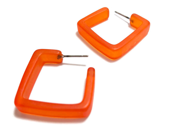 bright orange acrylic hoops