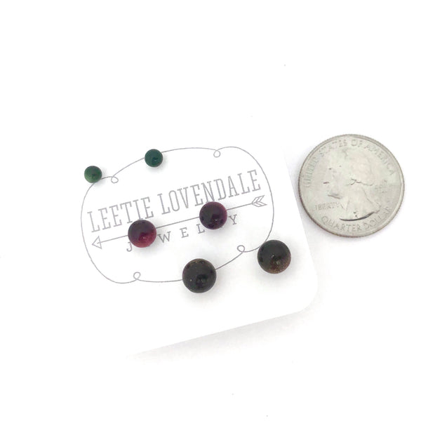 red moonglow studs