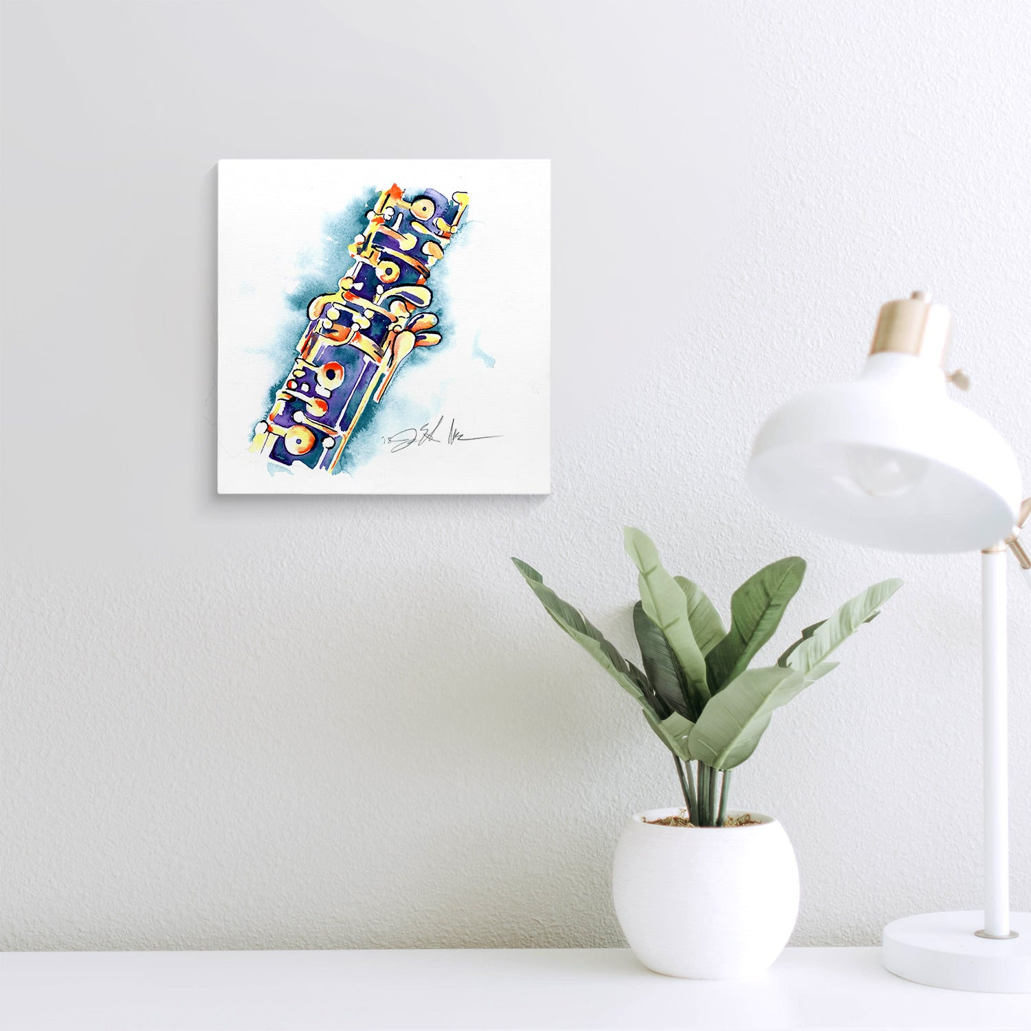 Blue and gold oboe painting on a wall