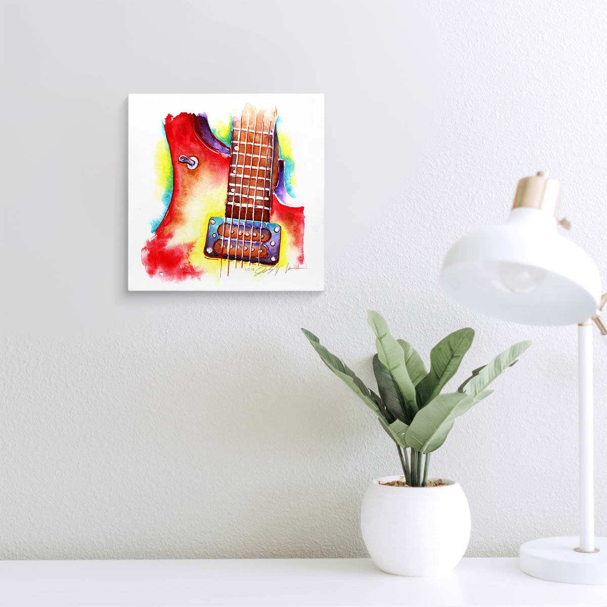 Red and yellow electric guitar painting on a wall