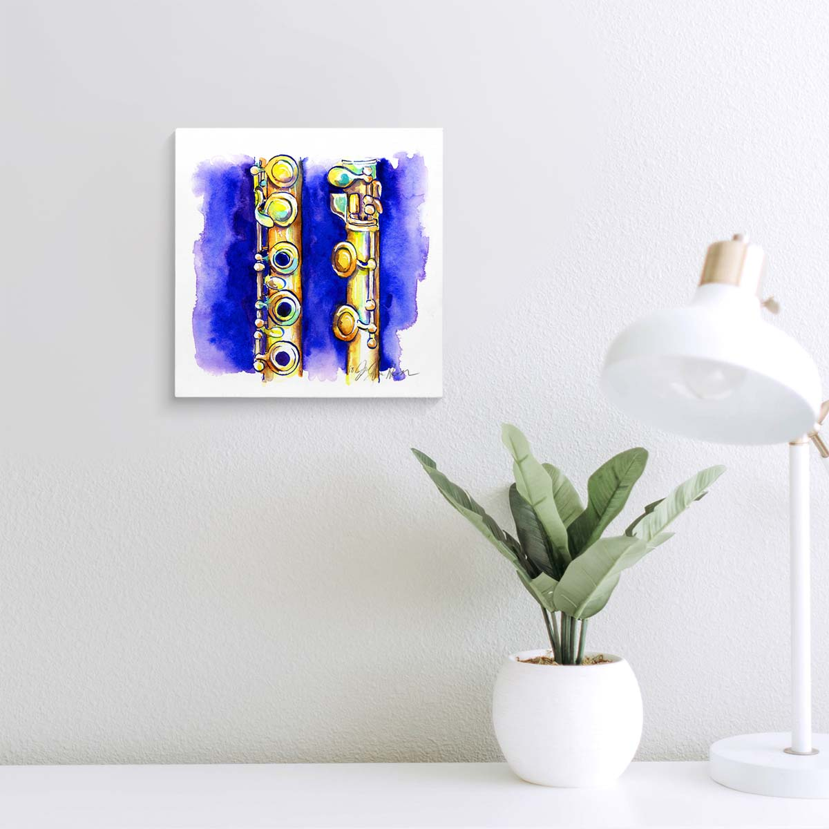 Blue and gold painting of a flute on a wall