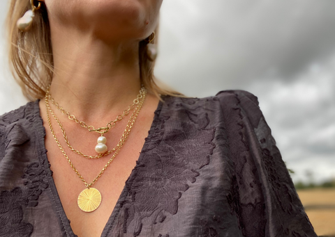 Image of some of the RAW Copenhagen designs featuring the textures hammered pendant and freshwater pearls
