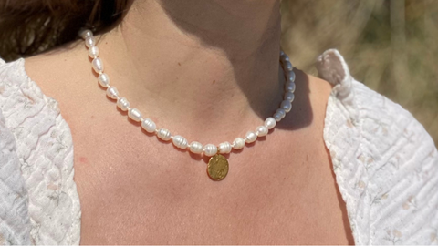 The RAW Copenhagen Aphrodite Pearl Necklace, a classic string of pearls with a twist