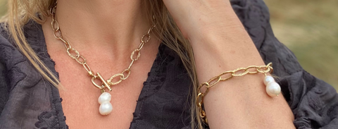 RAW Copenhagen Sisterhood Bracelet and Necklace featuring double freshwater pearls on chucky hammered gold vermeil chain closed with a toggle bar. Modern and funky pearl design made in the UK