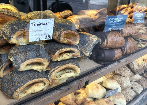 Pic of a typical window of a Danish Bakery with Tebirkes and various other buns