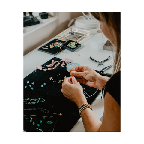 Picture of Karina Johansen, the designer at RAW Copenhagen, creating earrings with ethically sourced gemstones