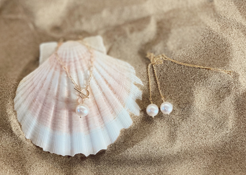 Modern Muse Earrings and Necklace from RAW Copenhagen featuring grade AAA white round freshwater pearls on a long threader earring