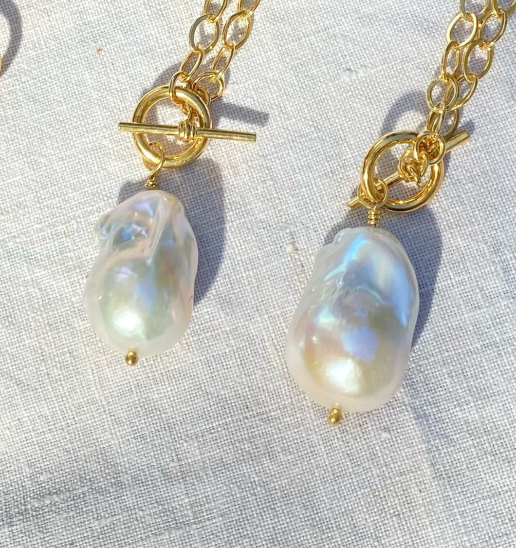 Cute small gold plated sterling silver hoops with cute perfectly imperfect white freshwater pearls. Designed in support of the NHS staff working with Covid-19 patients. 50 percent from all sales go to NHS Charities together