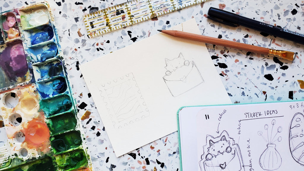 Sketching the design on watercolor paper