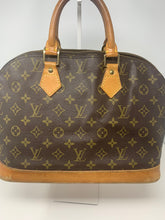 Perfect vintage designer bag made in France by Louis Vuitton