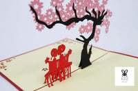 Cherry Blossom With Sitting Couple Pop Up Card