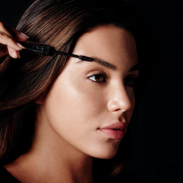 Using the comb side of Hi-Def Brow Gel's unique styling tool, shape and align brow hairs with short, upward strokes following the natural arch of your eyebrows. Twist and pull brow gel applicator brush from base. Using short, upward strokes, apply gel to eyebrows, moving from the inner to outer corners to sculpt and define.
