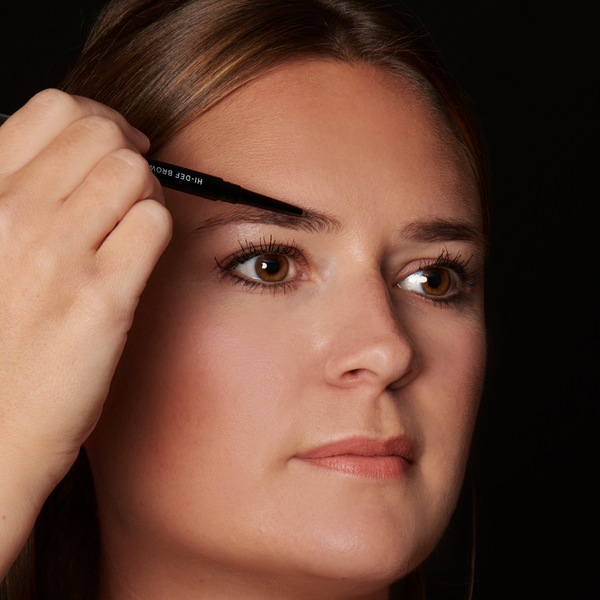 Begin applying to the fullest part of your brow, slowly adding definition and filling in sparse areas using short strokes. Add more strokes to build a bolder brow look.  Use the brush side of pencil to add shape and gently blend the color through brows.
