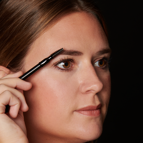 Use the brush side of pencil to add shape and gently blend the color through brows.  Tip: Use in tandem with Hi-Def Brow Gel to lock in your look.