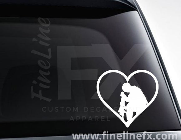 Praying soldier in a heart vinyl decal / Sticker - FineLineFX