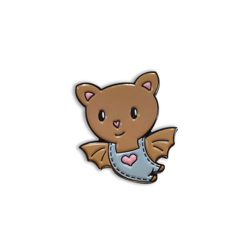 Cute baby bat cartoon pin wearing overalls with a heart stitched on the front