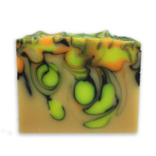 Soap bar with swirls of neon yellow and orange outlined with thin streaks of black