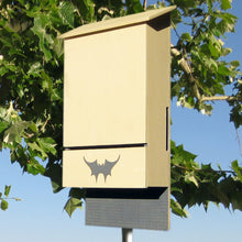 Austin Batworks' four-chambered bat box with foliage in the background