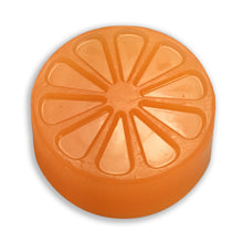 Orange candied citrus soap from a round mold