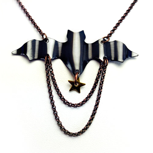 Necklace with antique copper bat hand cut and rippled, two layered chains and dangling star