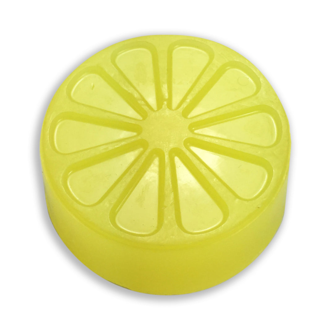 Yellow candied citrus soap from a round mold