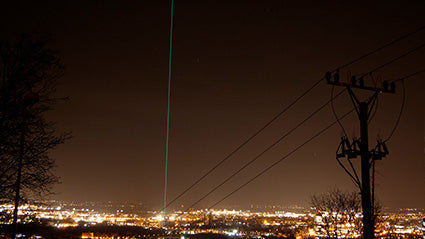 Green sky laser beam from long distance