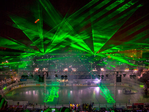 Kvant laser show with laser text displayed at hockey game