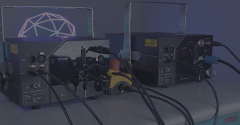 Multiple laser show projectors being controlled at the same time