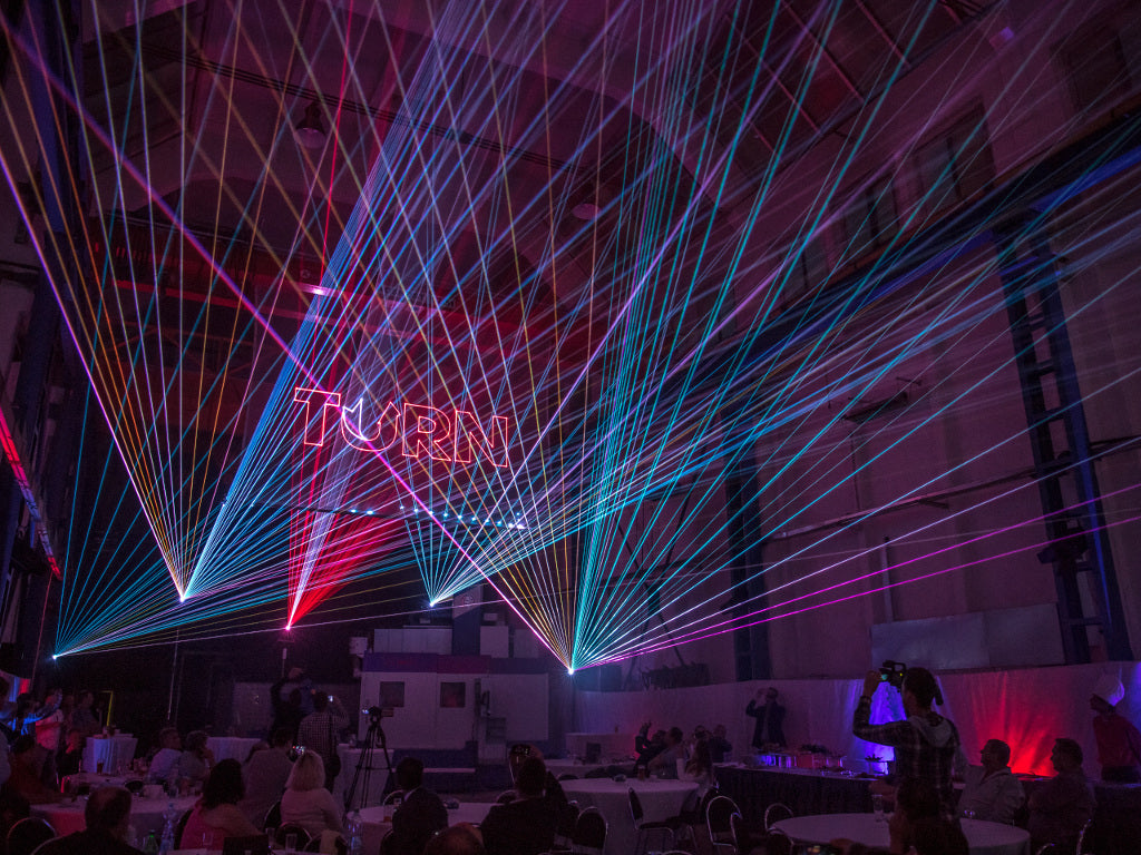 Corporate laser show with aerial laser beams and 3D laser text