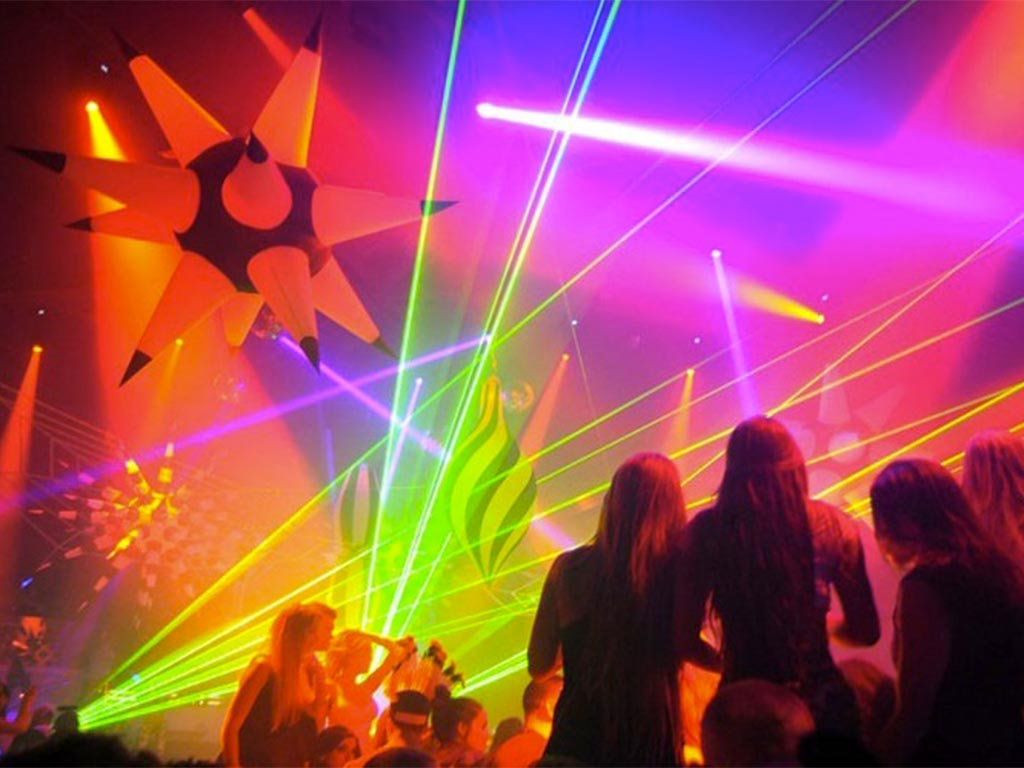 Green aerial laser beams inside of nightclub