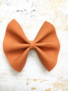 Hazel  - pumpkin orange suede bow