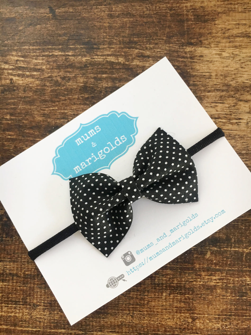 Emma - black with white polka dots cotton bow with black nylon headband