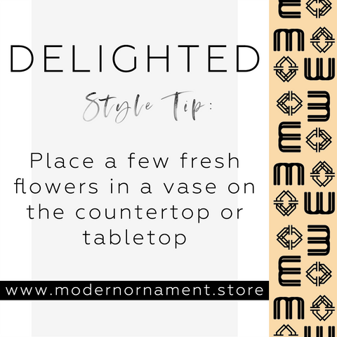 Modern Ornament Style Tip:  Place a few fresh flowers in a vase on the countertop or tabletop.