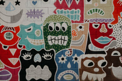 Colorful Graffiti Style Wall Art showing faces with different emotions