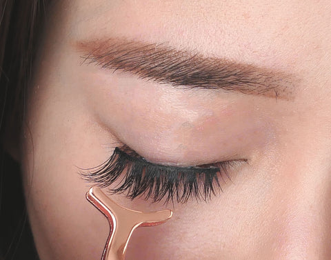 85c0c8d5dc7 You can use your fingers or a lash applicator to put lashes in place. Look  down at a mirror on a 45 degree angle (moving your eyes and not your head),  ...