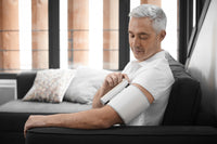 A Man is checking his blood pressure with the Withings / Nokia Wireless Blood Pressure Monitor - FitTrack Australia