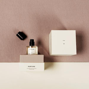 bottle of 100% natural perfume with box by abel odor and gray label named nurture