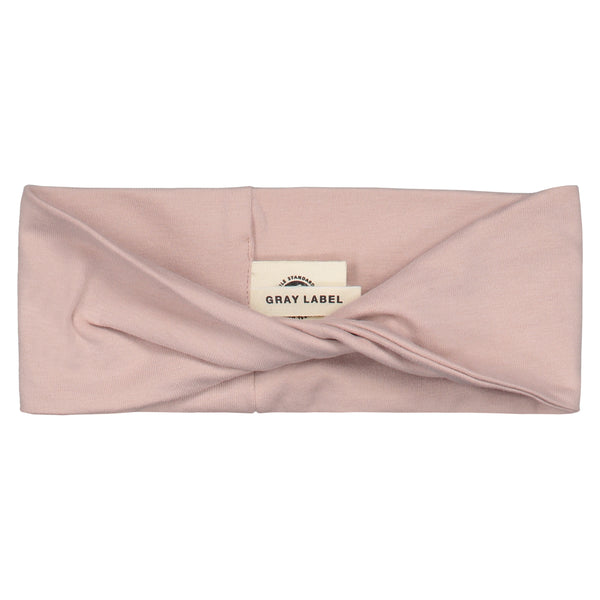 Headband with a twisted front in vintage pink made of organic cotton.