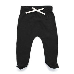 Black baby leggings with footies and a white draw string made of organic cotton