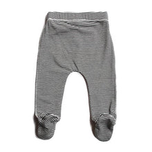 Black and white striped baby leggings with footies and a white draw string made of organic cotton back