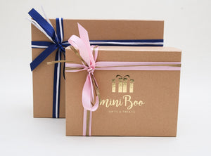 MiniBoo Gifts beautifully wrapped kraft gift box with pink and gold or blue and white ribbon