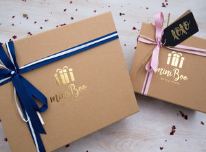 Bespoke miniBoo branded kraft gift box tied with ribbon