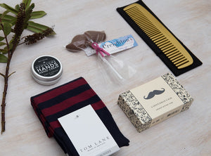 Luxury curated gift box items - Tom Lane socks, Dartmoor Soap Co. Bar, Creighton's Moustache, Men's Society Comb & Hand Cream