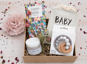 Luxury curated gift box with Sister & Co Dream Cream, Blossom & Bear teething ring, Lovely Ink cards, Coco Chocolatier bar