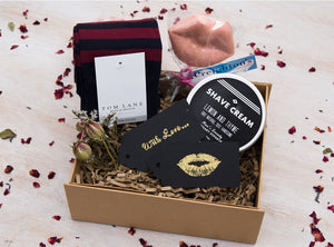 Luxury curated gift box with Tom Lane socks, Men's Society Shave Cream and a Creighton's chocolate kiss lollipop