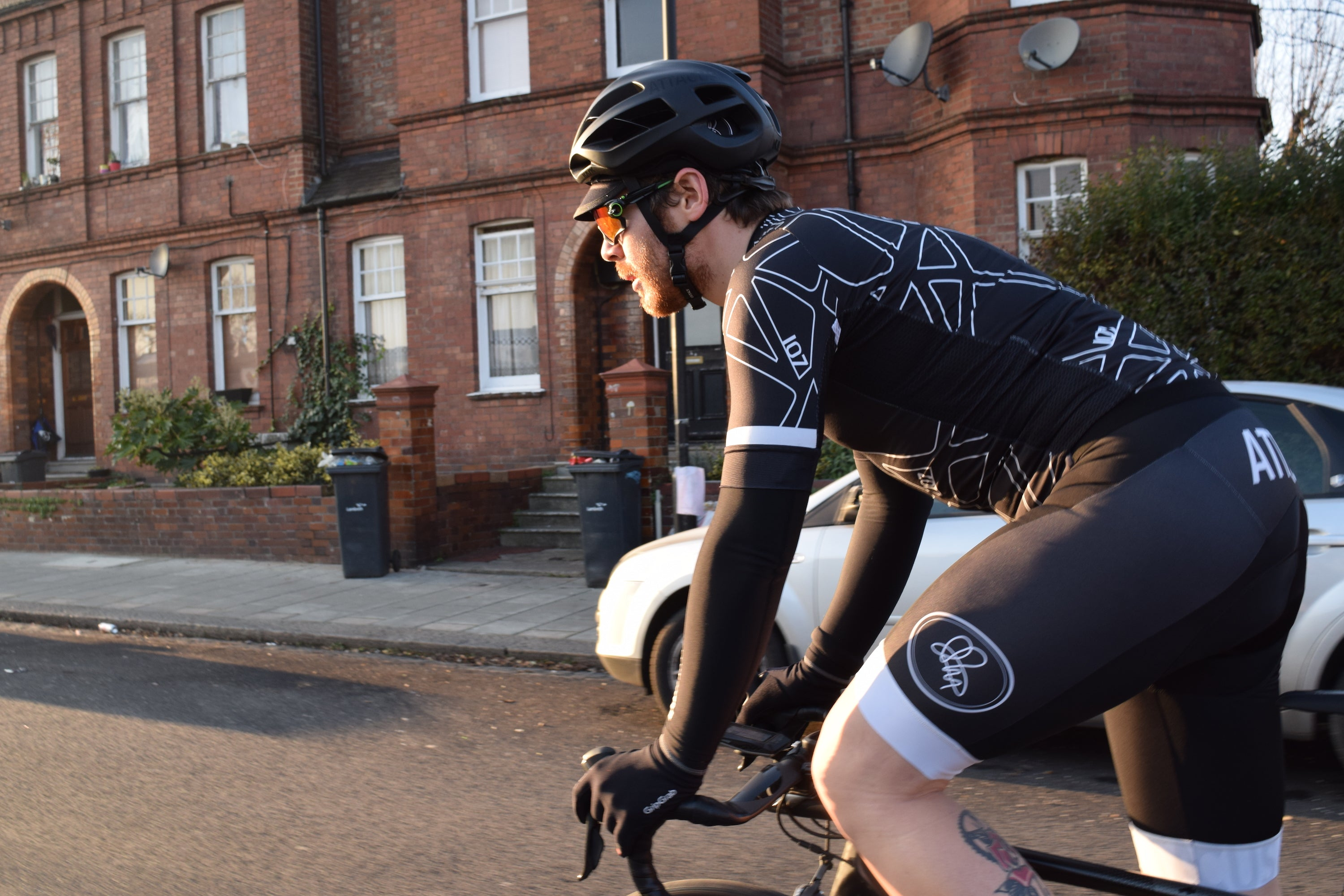 Chris Hall rides 107 for 107 in Attacus Cycling jersey and bib shorts