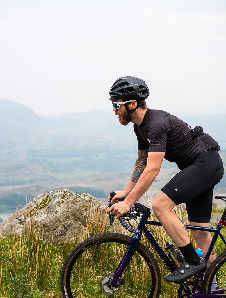 Endurance cyclist Chris Hall talks Silk Road Mountain Race 2018 wearing Sweet Spot Cycling Squad black cycling Jersey and black bib shorts