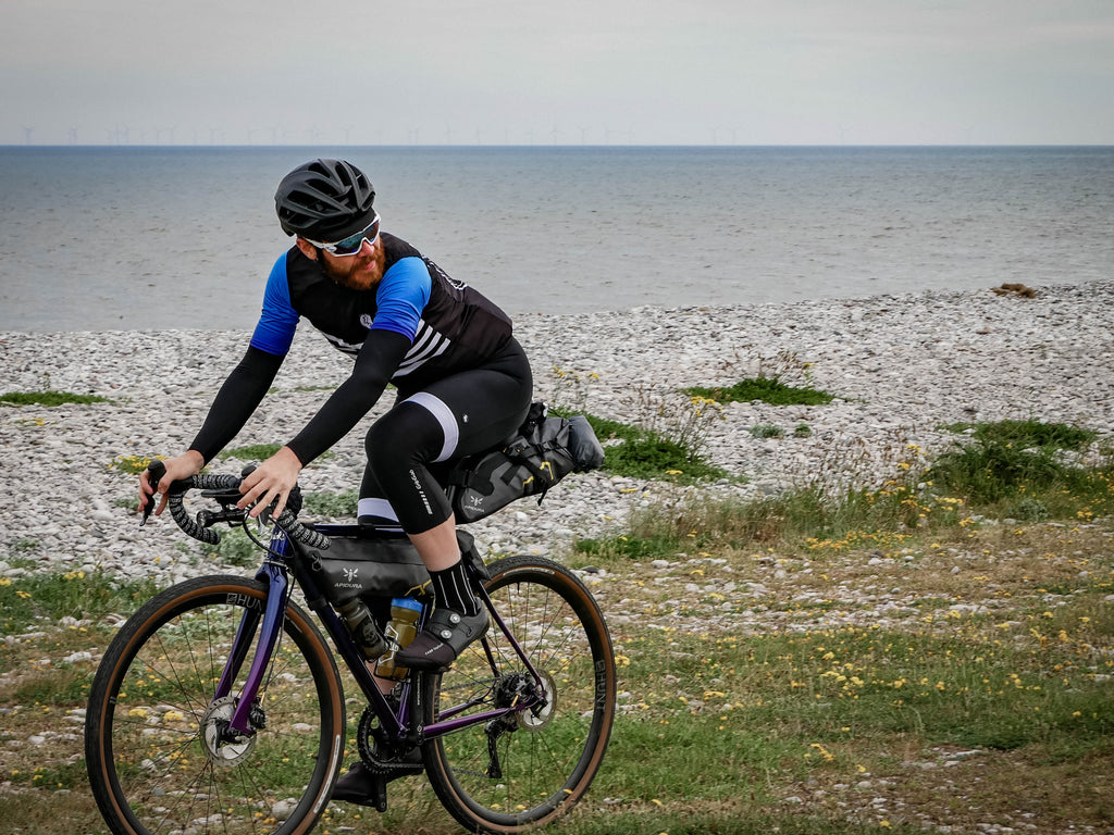 Endurance cyclist Chris Hall talks Silk Road Mountain Race 2018 wearing Sweet Spot blue dissolve cycling Jersey dark dagger gilet and black bib shorts