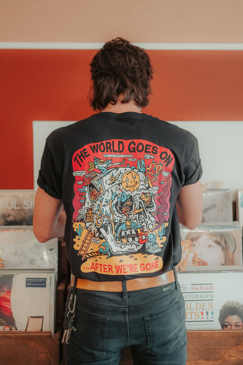 THE WORLD GOES ON TEE
